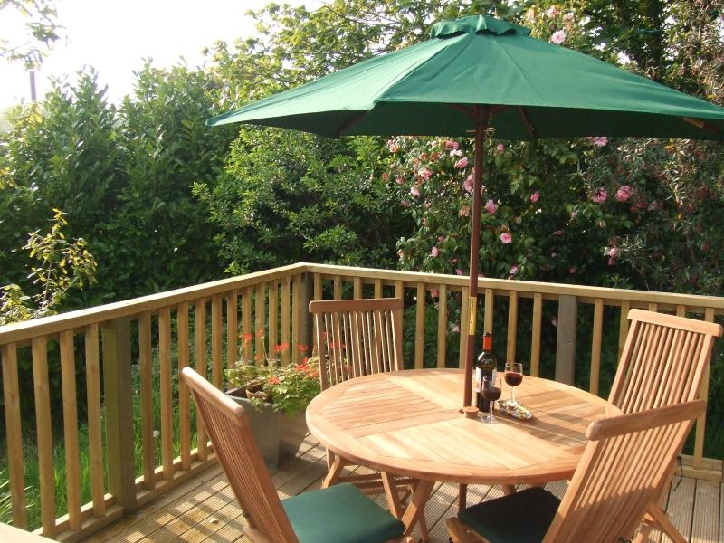 Holiday apartment private deck with patio furniture-outdoor dinning.