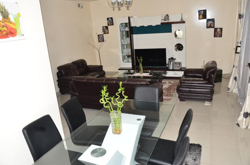 a large lounge with a dining area that can serve as office