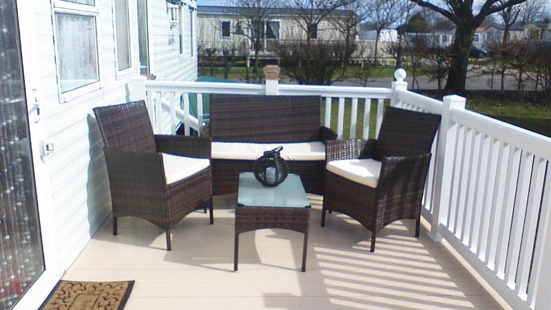 Our lovely new veranda decking with lovley new stylish rattan furniture for your outside relaxation.
