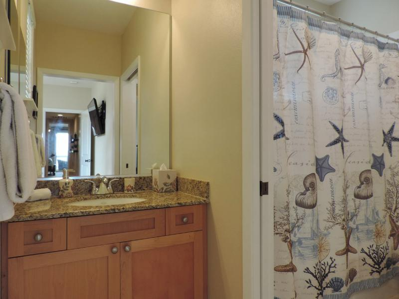 Jack and Jill Bath shared with Queen Bedrooms.