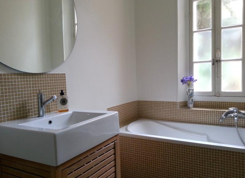 bathroom with window and shutters