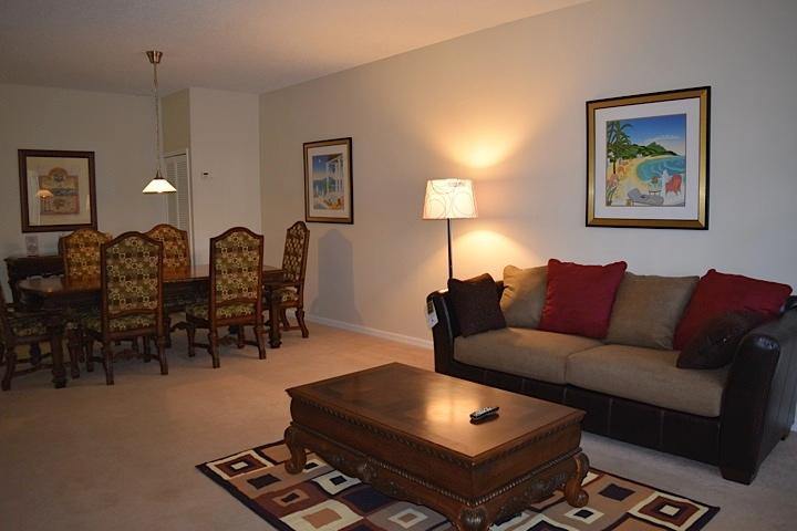 Spacious living room with new sofa and flat screen TV.