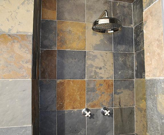 Rainfall shower head, old tymie knobs in our locally-quarried slate shower.