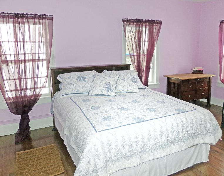One of our upstairs suites . . . a queen bed and a futon . . .