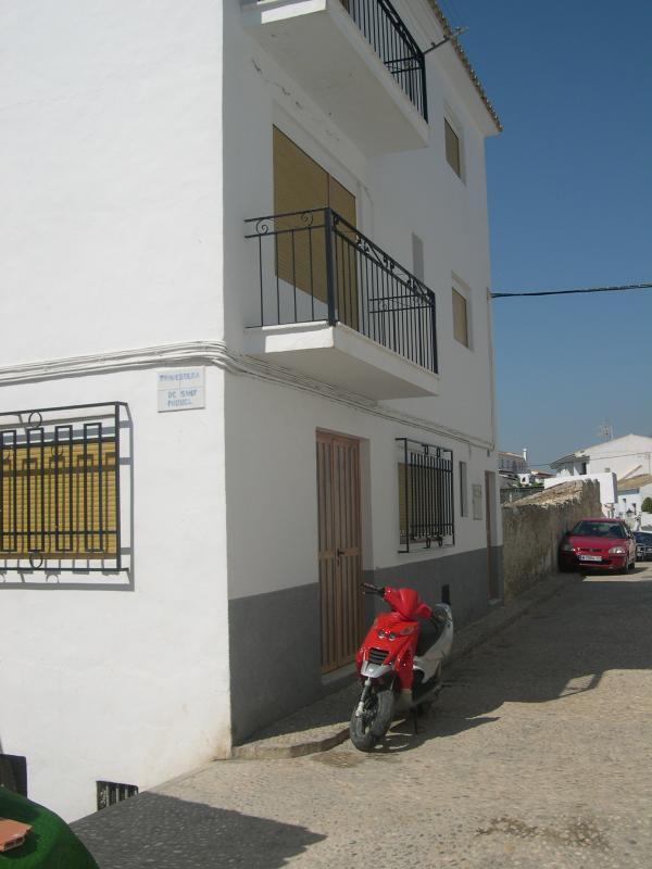 Behind house outside sea