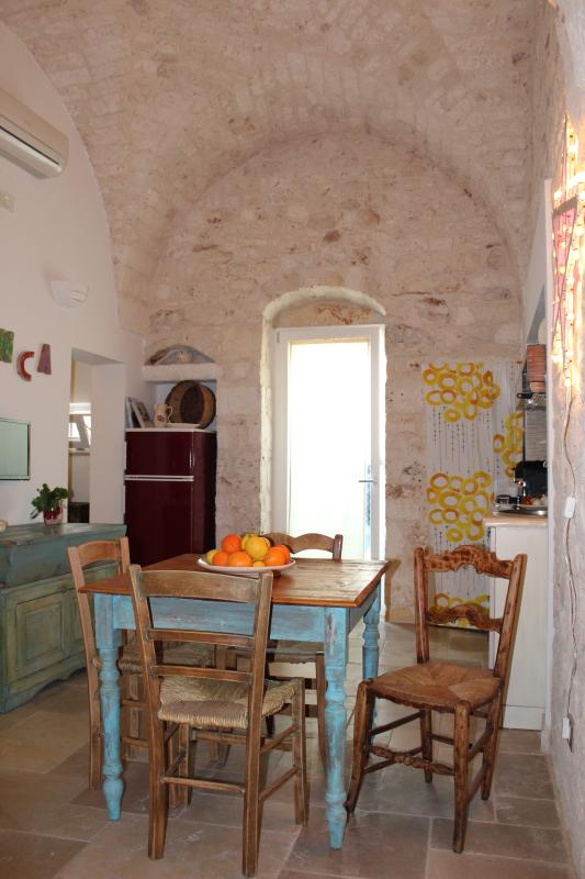 The living room is decorated with typical apulian furnitures