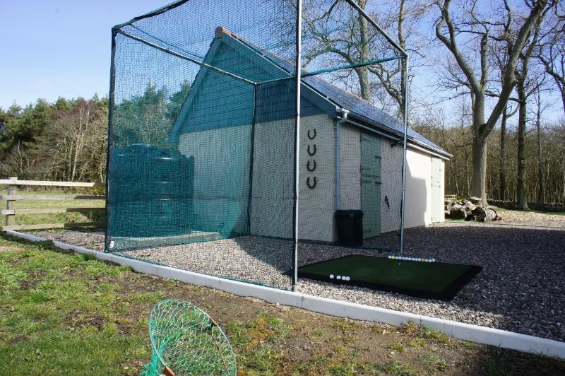 The house sits in an acre of its own land and has a golf practice area with driving net.
