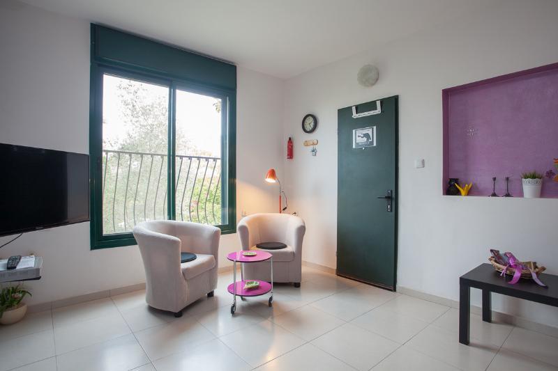 Living room: green entry door