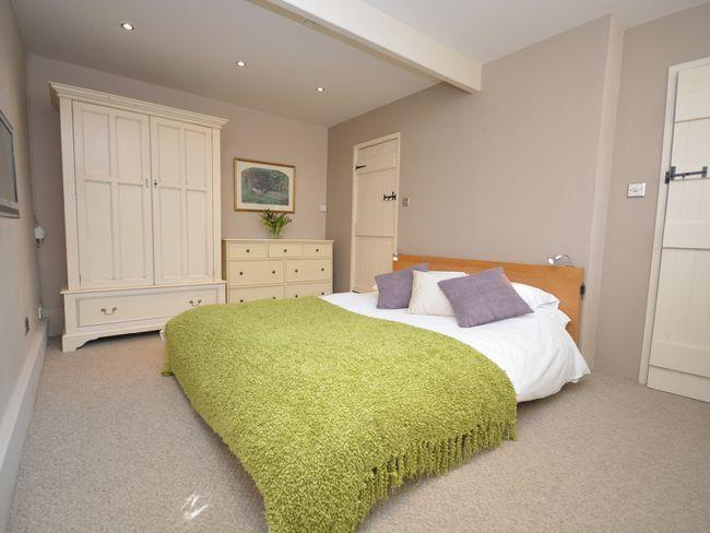 Bedroom with super king bed and wall mounted TV/DVD