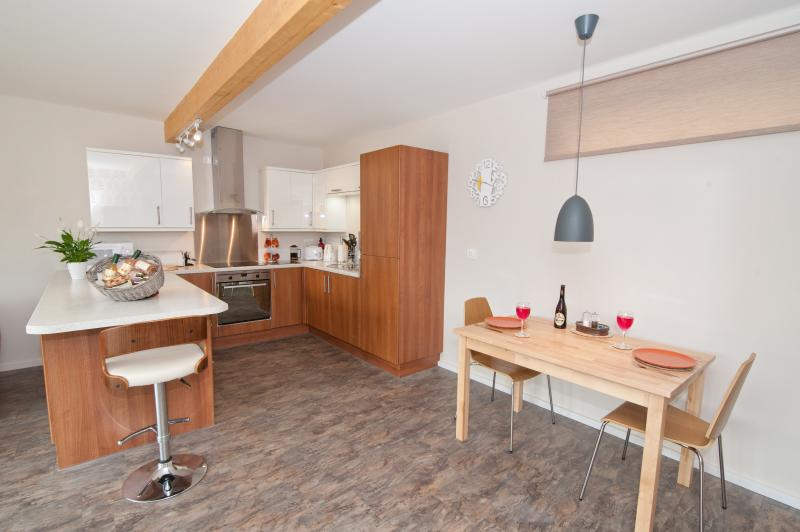 Stunning contemporary design with fully equipped kitchen, and adjoining dining area.