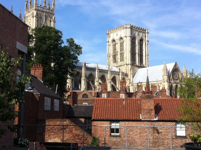Secluded courtyard with seating and views of The Minster