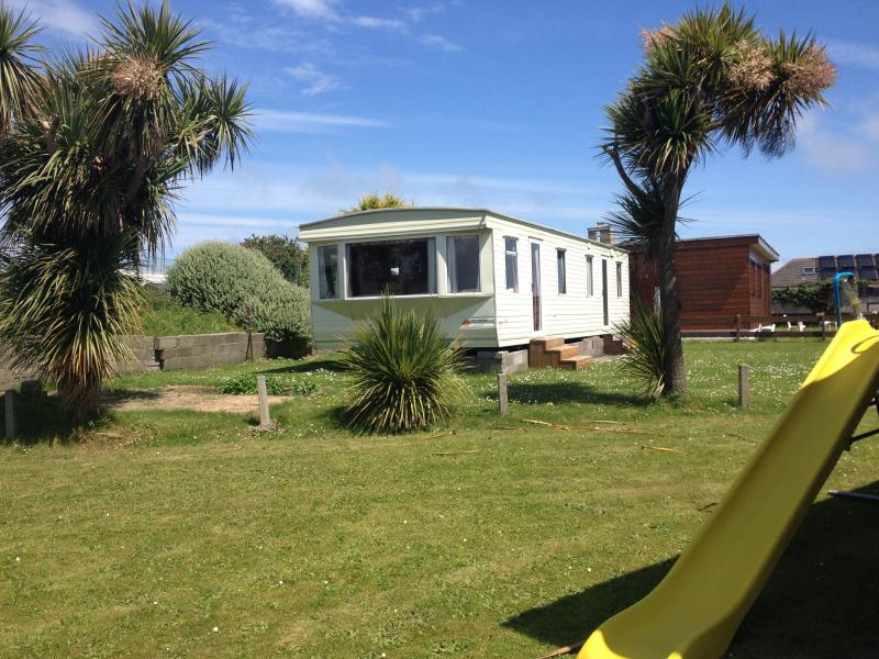 Large caravan on own site within a small hamlet of 6 dwellings. Very safe and quiet 80mts from beach