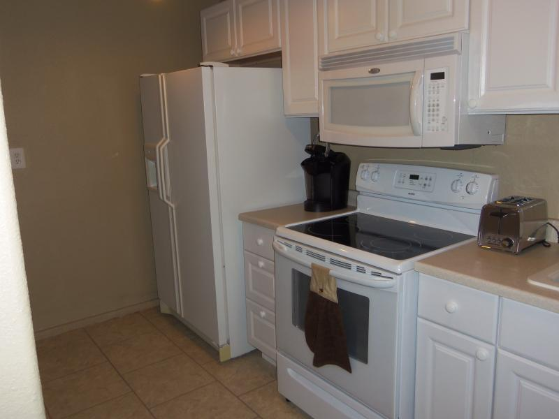 Kitchen Side-By-Side Refrigerator, Microwave, Glass Top & Oven & Cabinets