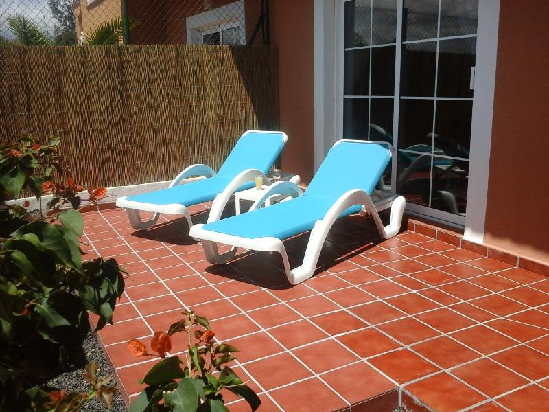 relax on the secluded sun terrace to top up your tan
