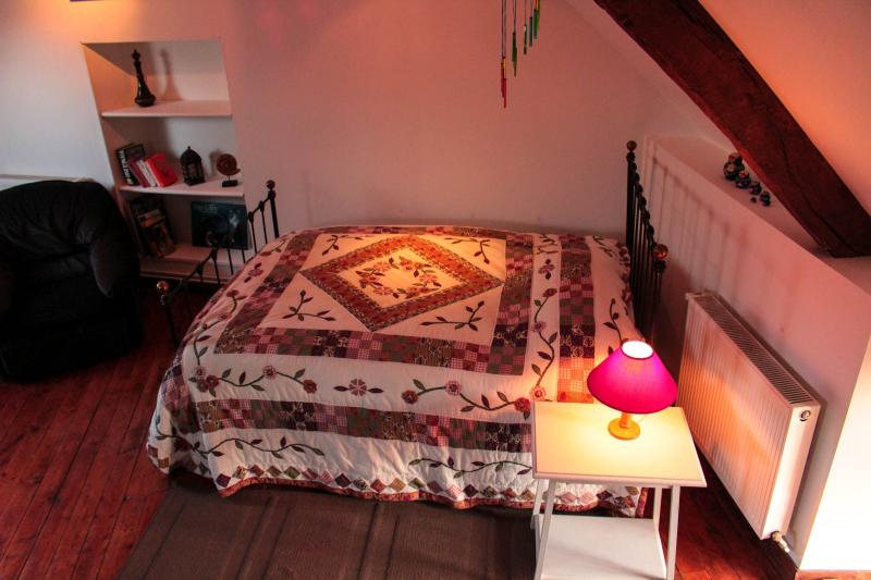 third bedroom with two double beds, a single bed and lounge area