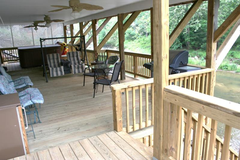 1Br. deck side view ALL our rentals have massage chairs, Hot Tubs are GREAT!