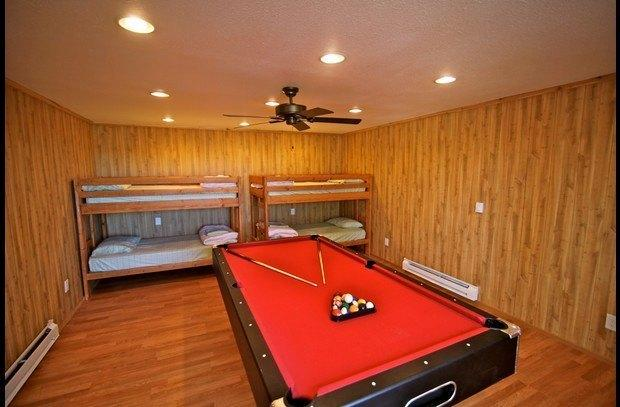 Pool table and bunk beds in room under the deck