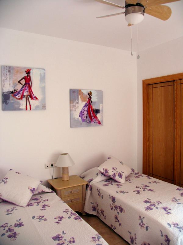 twin bedroom with fully fitted wardrobes for all your clobber!