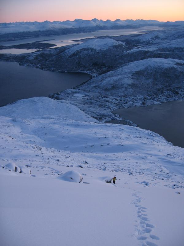 Getting small in the large mountains. Ersfjorden village in the background. December
