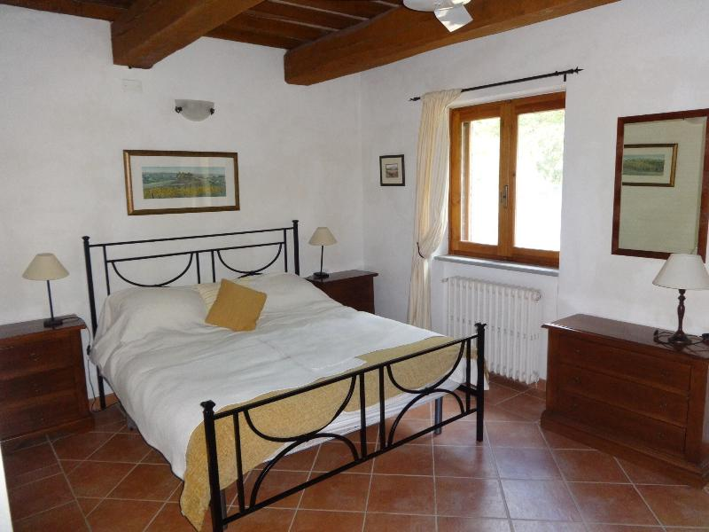 Double room with door opening to private wisteria covered terrace