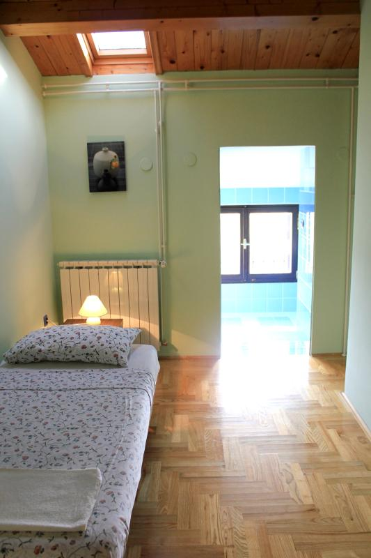 First bedroom with single bed