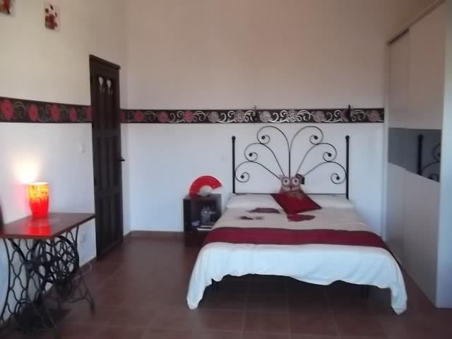 Bedroom / lounge with double bed,  large wardrobe. 42 inch  TV.Wifi, DVD player etc.