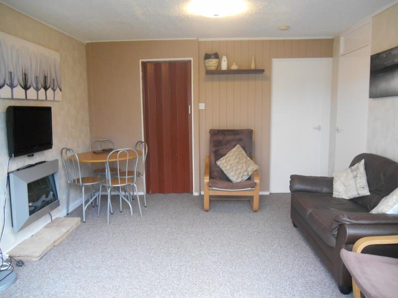 Spacious Lounge / Diner, with flat screen freeview digital TV, two seater sofa & 2 chairs