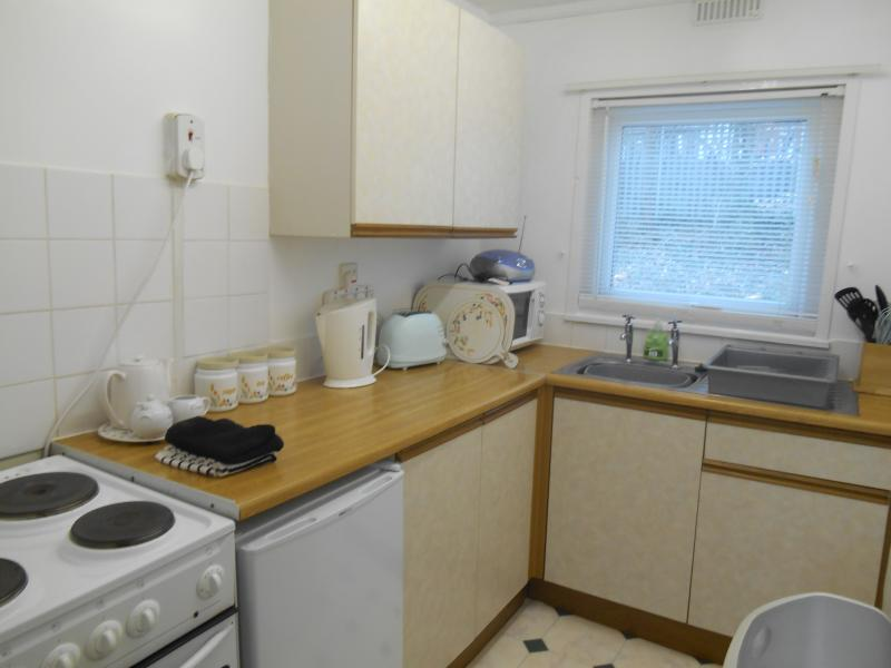 Kitchen incorporating electric oven & grill, microwave, fridge & toaster