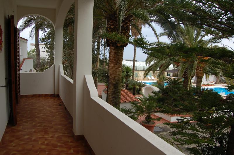 wide balcony over a garden