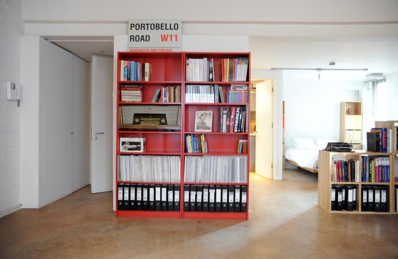 Bookshelves in living area (1 & 1/2 height ceiling)