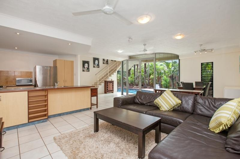 Spacious lounge adjoins fully equipped kitchen