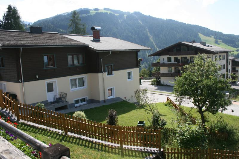 The view of House Andre from House Oliver in summer with Grafenberg in the background