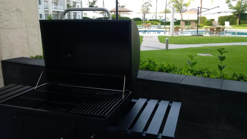 Grill overlooking the pool
