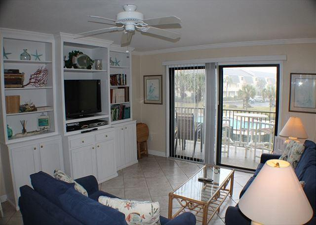 Living room with queen sleeper sofa.  Flat screen TV and ocean view balcony.