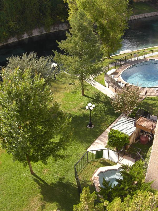 View of swimming pool, the river and hot tub from our balcony
