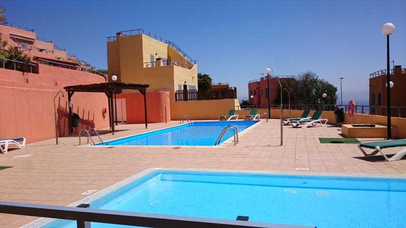 Two Swimming Pools With Plenty Of Sun Loungers