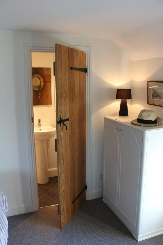 En-suite: Has a large shower cubicle with fixed and movable, rain shower heads, hand basin and a WC.