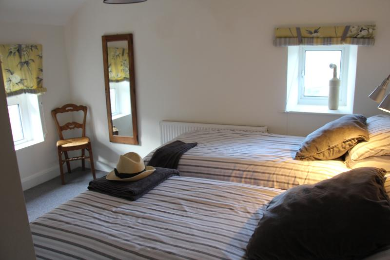 The twin bedroom has two large single beds with comfortable, semi firm mattresses,
