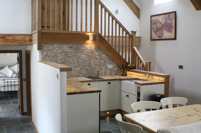 The kitchen area with stairs up to the second bedroom suite