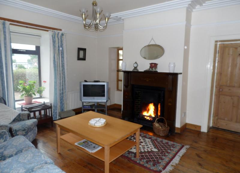 Sitting room with cosy open fire