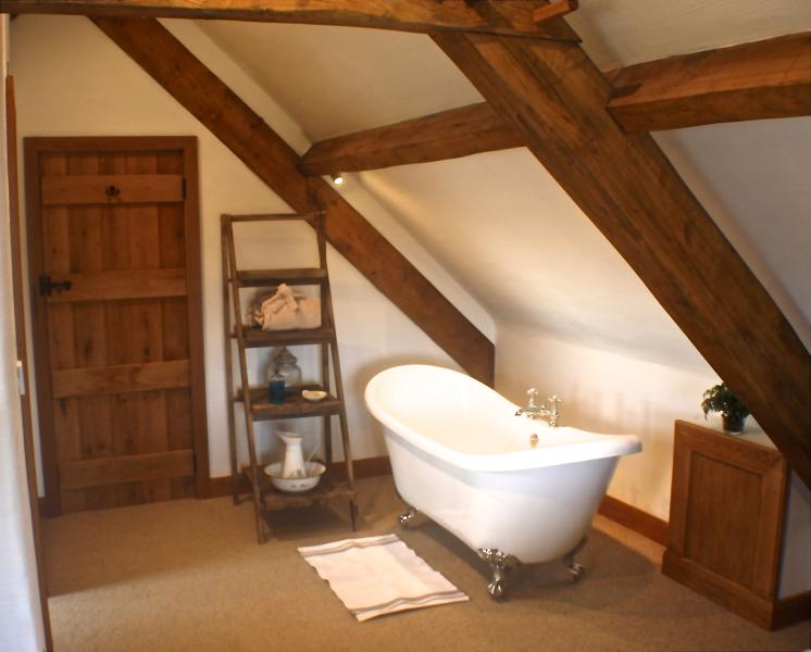 The roll-top bath has been positioned to enjoy a soak whilst admiring the views