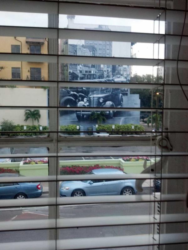 Looking out room window towards S. Pineapple Avenue, mural by Eduardo Kobra