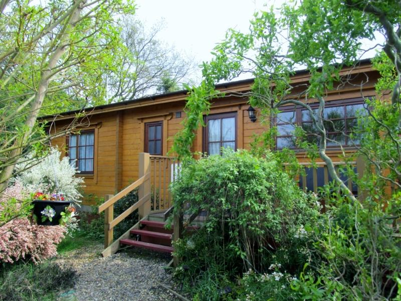 Holly Lodge, 4 Star Gold rated log cabin, quiet location.  4 more lodges available.  No pets.