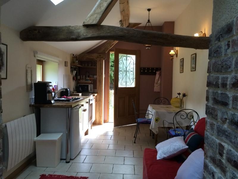 lounge, kitchen and eating area with the oak beams etc