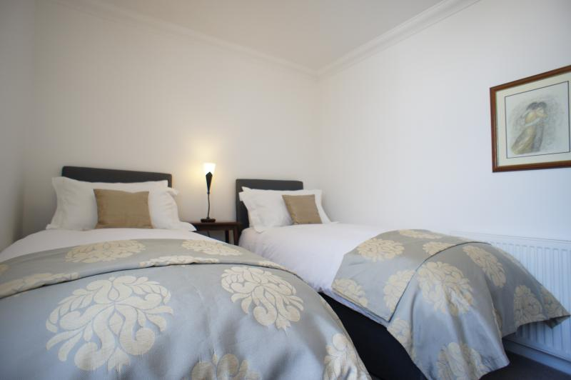 Twin bedroom with zip and link beds, can be made up as a king-size, quality bed linen provided