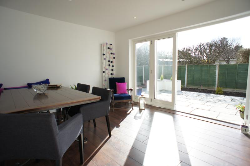 Large sunny kitchen diner with patio doors leading to a great garden area that is fully enclosed