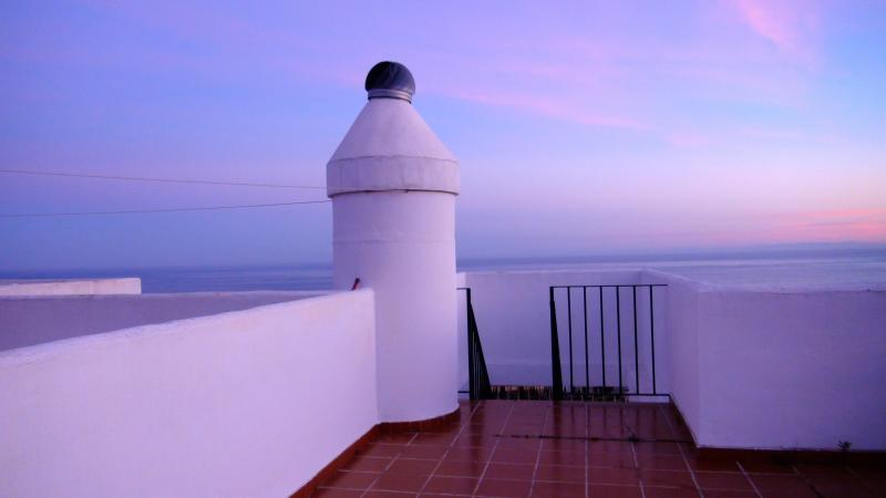 The roof terrace at sunset. 50m2 pure enjoyment. With a pergola, sunbeds, and 360° views