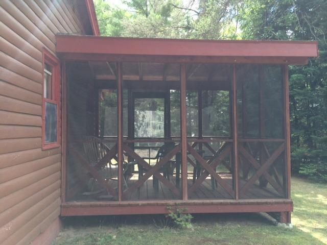 View of attached screenporch from behind (facing lakeside)