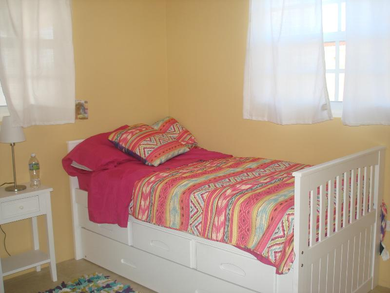2nd bedroom with twin trundle bed, ceiling fan, wardrobe and A/C