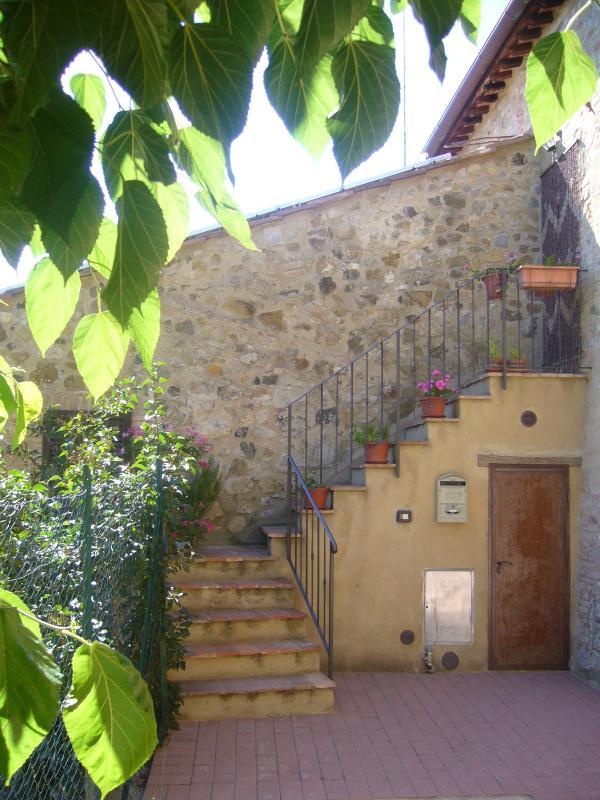 A entrada para a casa e espaço aberto